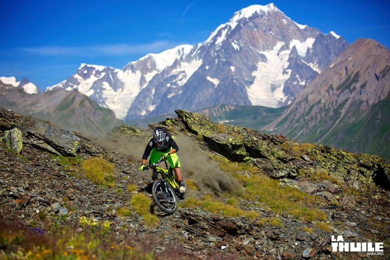 Sven Martin raising some dust. Mt. Blanc in the background
