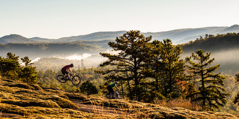 Brandon and Evan ride mountain bikes in Dupont State Forest near Brevard, NC.