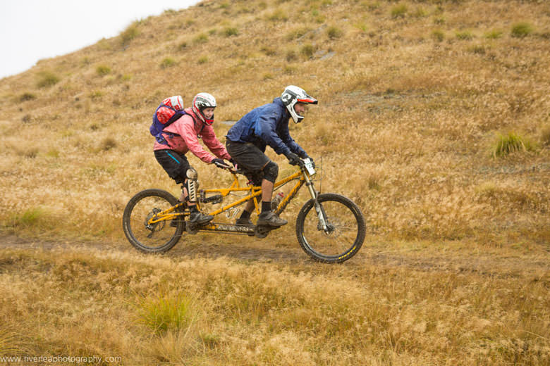Love is… riding tandem in bad weather.