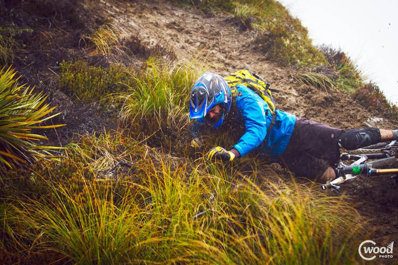 Another rider gets a taste for Queenstown mud.