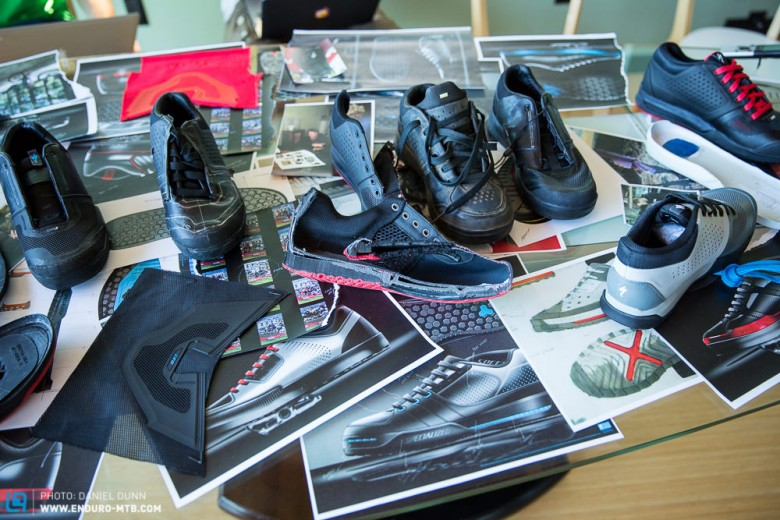 Many different itinerations of the shoe, including a slice down the middle.