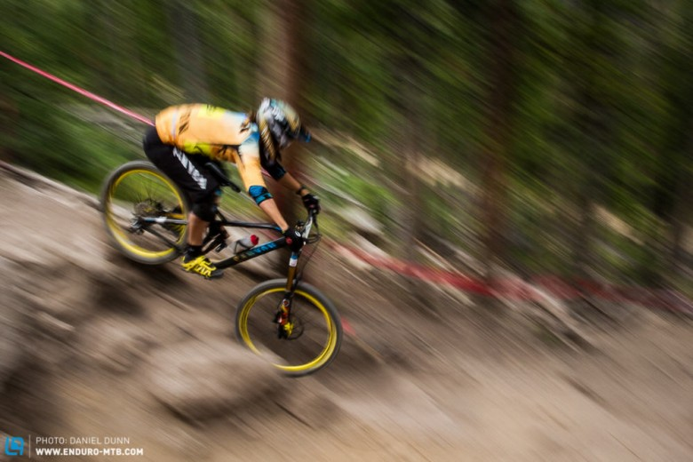 Ines Thoma blurring the lines of a steep, rocky bit on Stage 7.