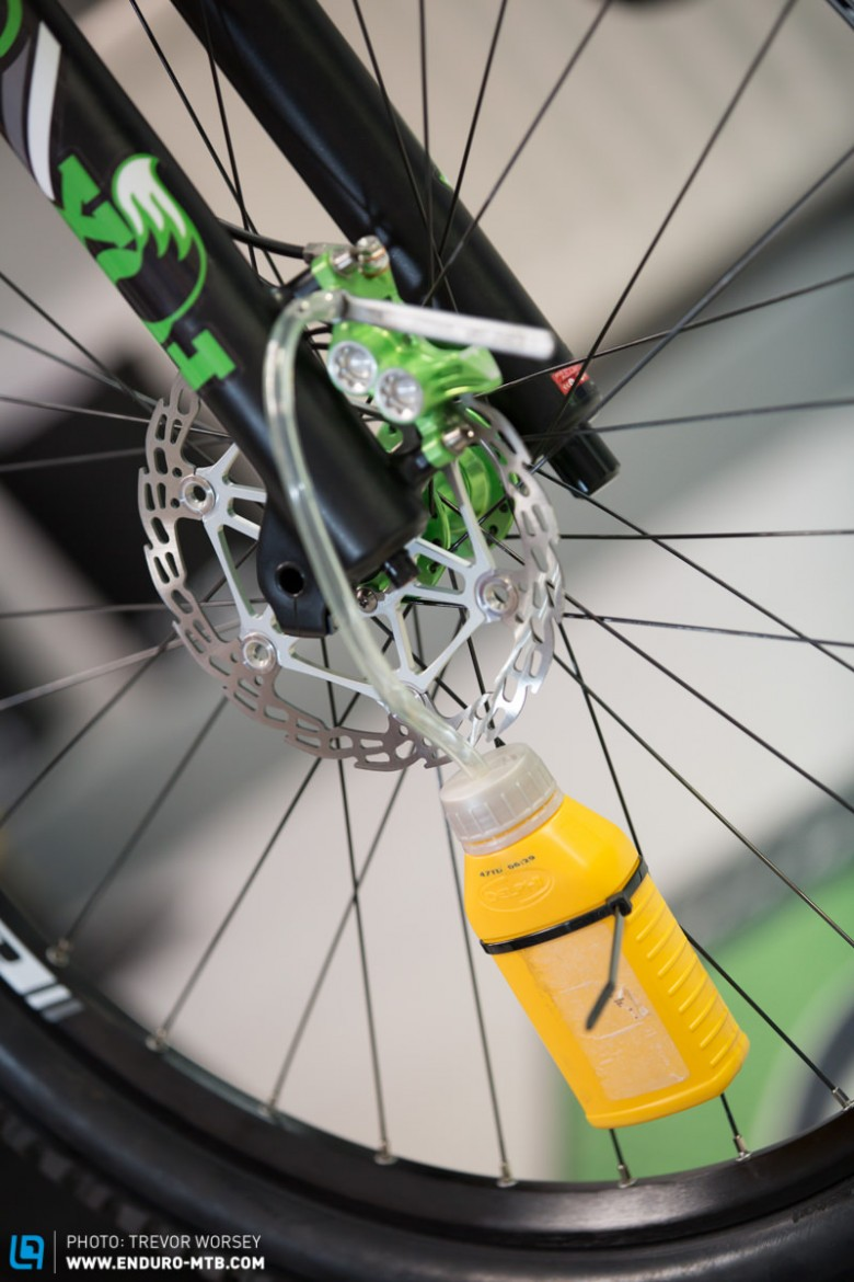 Cable tie the bottle to the spokes to keep it in position