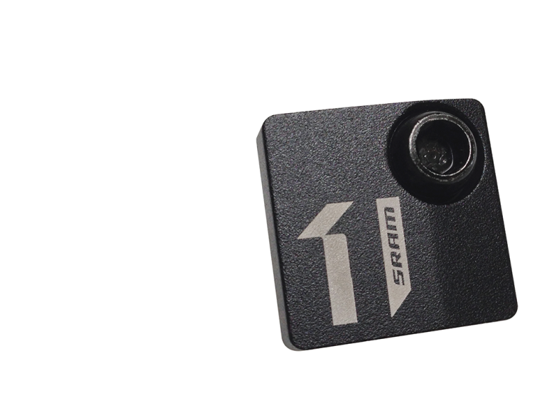 The SRAM 1x™ Badge is a small, CNC aluminum cover for mountain bikers who decide to eliminate their front derailleur in favor of SRAM 1x™