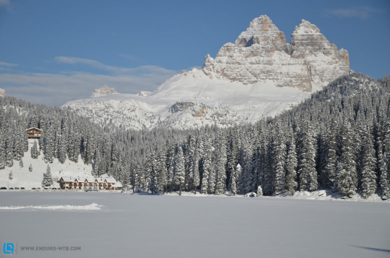 Riders get to enjoy the peaks of the Dolomites while tearing up the snow-covered trails.