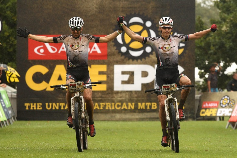 Christoph Sauser and Jaroslav Kulhavy from the Investec-Songo-Specialized team celebrate their victory in the first stage of the Absa Cape Epic 2015.