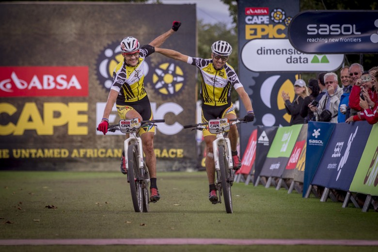 Jaroslav Kulhavy and Christoph Sauser (Investec Songo Specialized) taking their second win on the second stage of the Absa Cape Epic 2015.