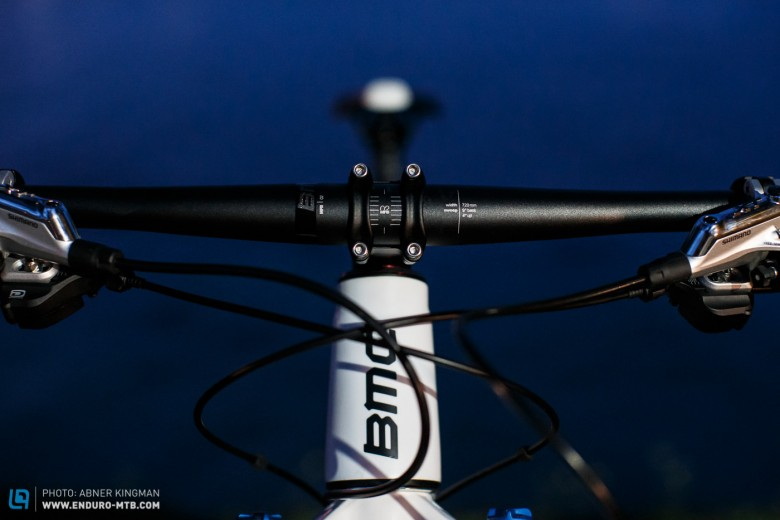 A flat bar and a slightly dropped stem create a low, stretched-out position.