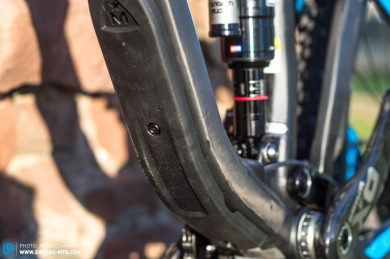Take off the replaceable down-tube protector and there's a handy slot to access internal cable routing.