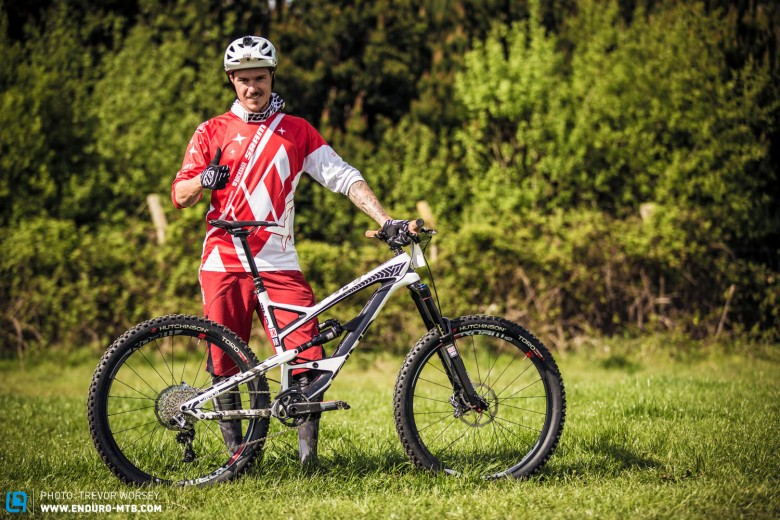 Bryan rides a YT Capra. Seemingly, it seems to suit him, with tattoo sleeves matching the camouflage of the bike.