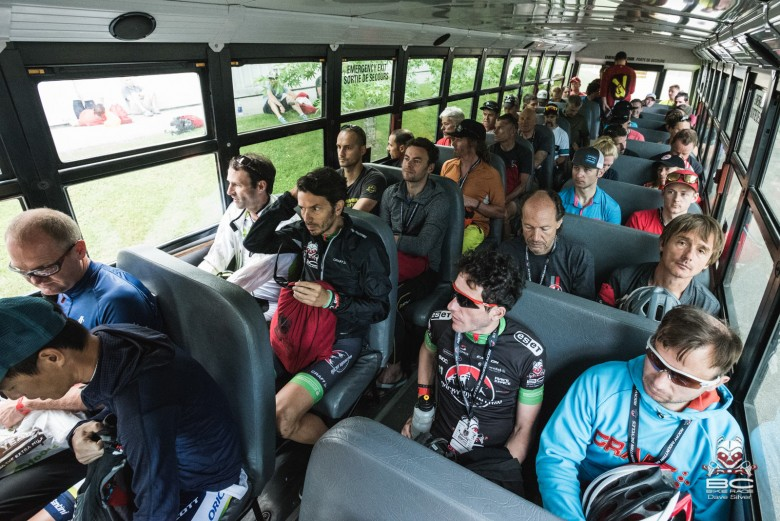Racers ride the bus to Stage 3.