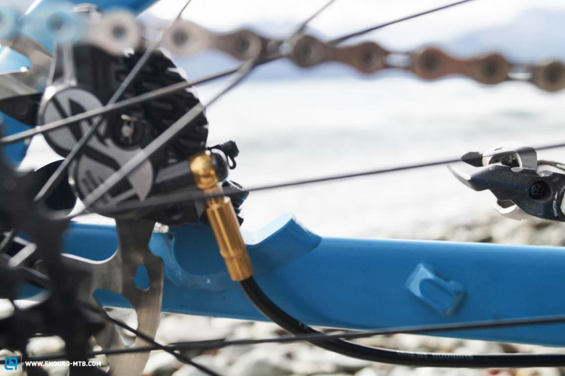 The Shimano Saint brakes were retro-fitted. There's no flexible hose adaptor for the brakes so you have to consider the brake line and not make it too tight and allow it to get kinked.